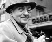 1950s --- Fritz Lang, Austrian-American film director and producer, wearing his habitual monocle.  --- Image by © Heinz-Juergen Goettert/dpa/Corbis
